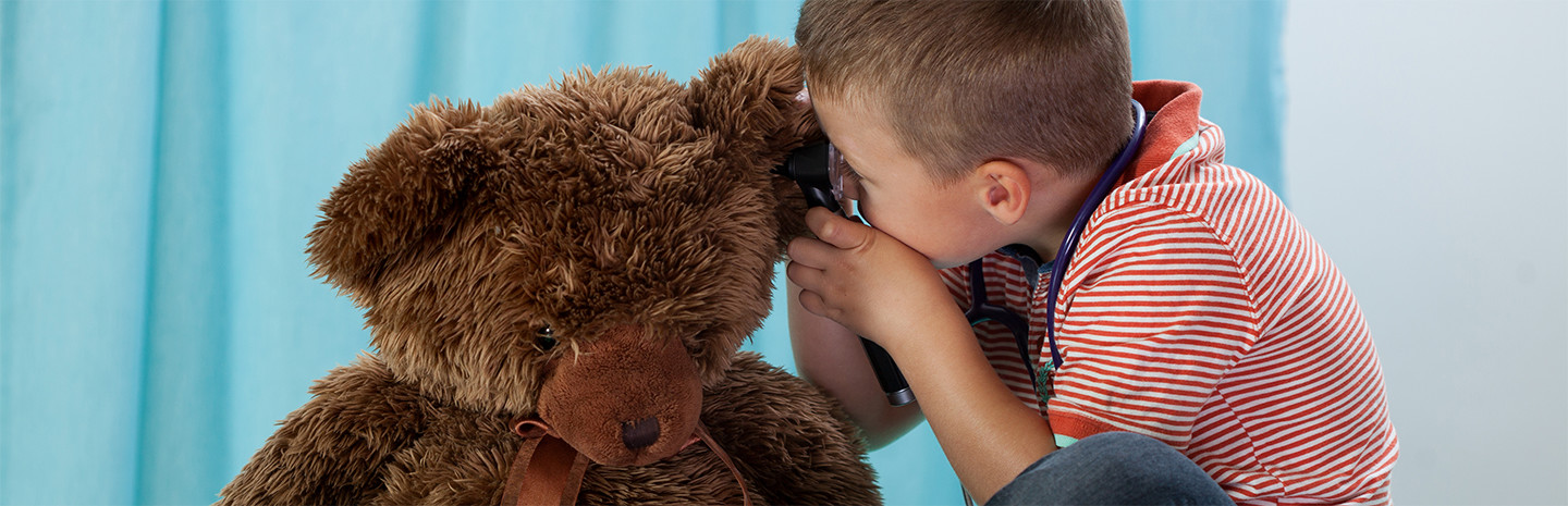 Child-examines-bear-for-ear-infection